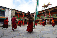 "China started building a controversial 67-mile ""paved highway fenced with undulating guardrails"" to Mount Qomolangma, known in the west as Mount Everest, to help facilitate next year's Olympic Games torch relay./// Monks do a spiritual dance at Rongbuk Monastery near Everest base camp."