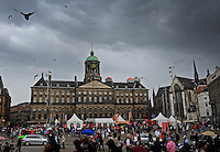 Overall view during a Holland Beach Soccer tournament at the base of the Royal Palace of Amsterdam in Dam Square bird pigeon tourists crowd people flock