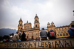 "A graffiti that reads ""god is black and lesbian"" is seen at Bolivar square during a march in Bogota, Colombia. 25/02/2012.  Photo by Eduardo Munoz Alvarez / VIEWpress."