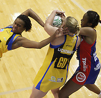 Pulse goalkeep Althea Byfield (left) loses her balance as Cushla Lichtwark and Pamela Cookey (right) fight for the ball during the ANZ Netball Championship match between the Central Pulse and Northern Mystics, TSB Bank Arena, Wellington, New Zealand on Monday, 4 May 2009. Photo: Dave Lintott / lintottphoto.co.nz