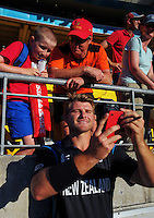 Corey Anderson poses for a selfie with fans after the ICC Cricket World Cup one day pool match between the New Zealand Black Caps and England at Wellington Regional Stadium, Wellington, New Zealand on Friday, 20 February 2015. Photo: Dave Lintott / lintottphoto.co.nz