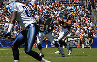 Sept. 17, 2006; San Diego, CA, USA; San Diego Chargers running back (21) LaDainian Tomlinson blocks for quarterback (17) Phillip Rivers against the Tennessee Titans at Qualcomm Stadium in San Diego, CA. Mandatory Credit: Mark J. Rebilas