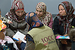 Zeinab El Hilawy, a lactation specialist from International Orthodox Christian Charities, a member of the ACT Alliance, talks with women in the community health center in Kab Elias, a town in Lebanon's Bekaa Valley which has filled with Syrian refugees. Lebanon hosts some 1.5 million refugees from Syria, yet allows no large camps to be established. So refugees have moved into poor neighborhoods or established small informal settlements in border areas. International Orthodox Christian Charities, a member of the ACT Alliance, provides support for the community clinic in Kab Elias, which serves many of the refugees.
