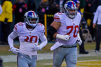 New York Giants cornerback Coty Sensabaugh (30) and center Weston Richburg (70)<br /> <br />  prior to a game against the Green Bay Packers on January 8th, 2017 at Lambeau Field in Green Bay, Wisconsin.  Green Bay defeated New York 38-13. (Brad Krause/Krause Sports Photography)