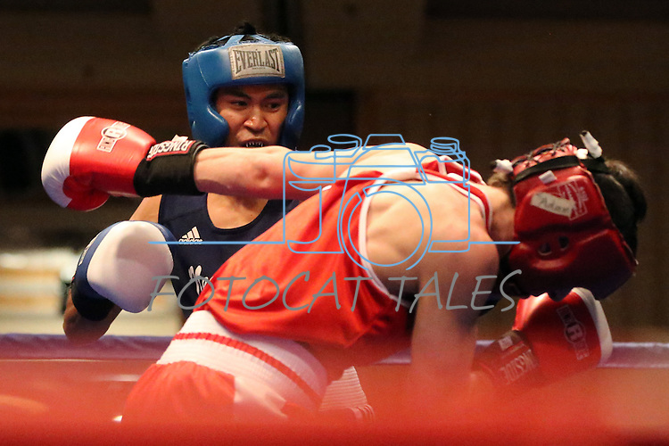 Nevada's JJ Mariano defeated Adam Feura of Lock Haven University during the Nevada Boxing bouts at the Eldorado in Reno, Nev., on Friday, Feb. 22, 2013..Photo by Cathleen Allison