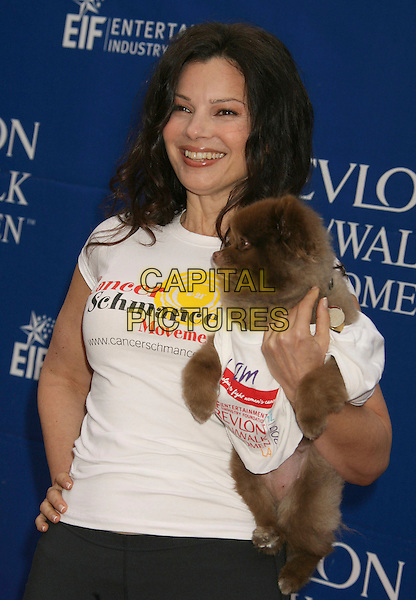 FRAN DRESCHER.14th Annual Entertainment Industry Foundation Revlon Run/Walk For Women held at The Los Angeles Memorial Coliseum, Los Angeles, California, USA,.12 May 2007..half length sporty black white carrying holding dog pet animal.CAP/ADM/RE.©Russ Elliot/AdMedia/Capital Pictures.