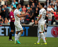 (L-R) Jordi Amat and team mate Federico Fernandez of Swansea City congratulate each other after the Premier League match between Swansea City and Chelsea at The Liberty Stadium on September 11, 2016 in Swansea, Wales.