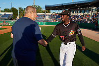 Batavia Muckdogs Milton Smith II (33) shakes hands with Booster Club President Hal Mitchell during a pre-game awards ceremony before a NY-Penn League game against the Auburn Doubledays on August 31, 2019 at Dwyer Stadium in Batavia, New York.  Auburn defeated Batavia 12-5.  (Mike Janes/Four Seam Images)