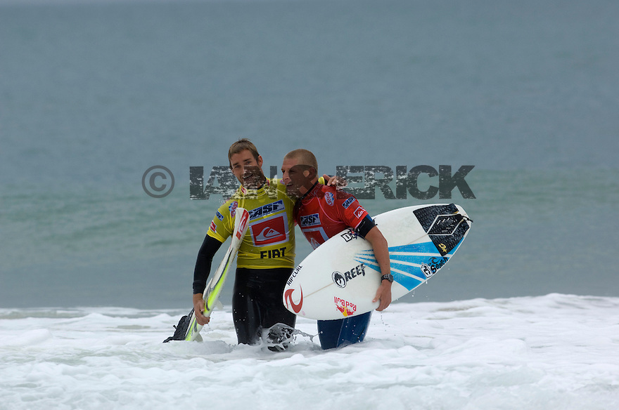 Troy Brooks congratulating Mick Fanning for his win in the Semi final during the Quiksilver Pro in Hossegor, France.