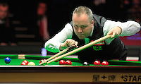 John Higgins uses a rest to aid his shot during the Dafabet Masters Q/F 4 match between John Higgins and Stuart Bingham at Alexandra Palace, London, England on 15 January 2016. Photo by Liam Smith / PRiME Media Images