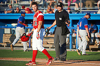 Batavia Muckdogs infielder Danny Stienstra #18 argues a call by umpire Clayton Hamm during a NY-Penn League game against the Auburn Doubledays at Dwyer Stadium on September 2, 2012 in Batavia, New York.  Batavia defeated Auburn 8-7.  (Mike Janes/Four Seam Images)