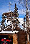 Log building of Old Saint Nicholas Church on a sunny day.  Eklutna Village Historical Park, Southcentral, Alaska, Winter.