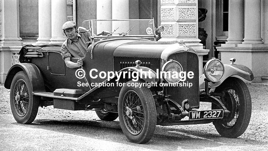 Henry Mulholland, 4th Lord Dunleath, Ballywalter, Co Down, N Ireland, at the wheel of an open-top Bentley in front of Ballywalter Park Mansion House. 197507000569a.<br /> <br /> Copyright Image from Victor Patterson, 54 Dorchester Park, Belfast, UK, BT9 6RJ<br /> <br /> t1: +44 28 9066 1296 (from Rep of Ireland 048 9066 1296)<br /> t2: +44 28 9002 2446 (from Rep of Ireland 048 9002 2446)<br /> m: +44 7802 353836<br /> <br /> e1: victorpatterson@me.com<br /> e2: victorpatterson@gmail.com<br /> <br /> The use of my copyright images is subject to my Terms &amp; Conditions.<br /> <br /> It is IMPORTANT that you familiarise yourself with them. They are available on my website at www.victorpatterson.com.<br /> <br /> None of my copyright images may be used on a website unless they are visibly watermarked, i.e. &copy; Victor Patterson within the body of the visible image. Metadata denoting my copyright must NOT be deleted. <br /> <br /> Web use is extra at currently recommended NUJ rates.
