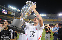 DC United midfielder Santino Quaranta (25) lifts the Lamar Hunt US. Open Cup after the victory, DC United defeated The Charleston Battery 2-1, to win the  Lamar Hunt U.S. Open Cup at RFK Stadium in Washington DC, Saturday September 3, 2008.