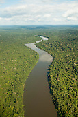Novo Progresso, Para State, Brazil. Flight to Aldeia Bau, aerial view, unbroken rain forest with winding Curua River.