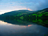 Landscape reflected in the reservoir water in Wales.<br />