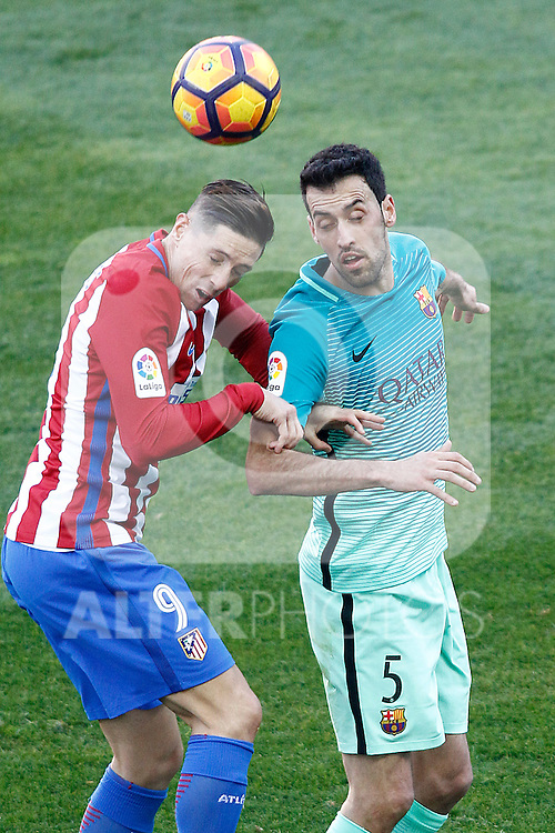 Atletico de Madrid's Fernando Torres (l) and FC Barcelona's Sergio Busquets during La Liga match. February 26,2017. (ALTERPHOTOS/Acero)