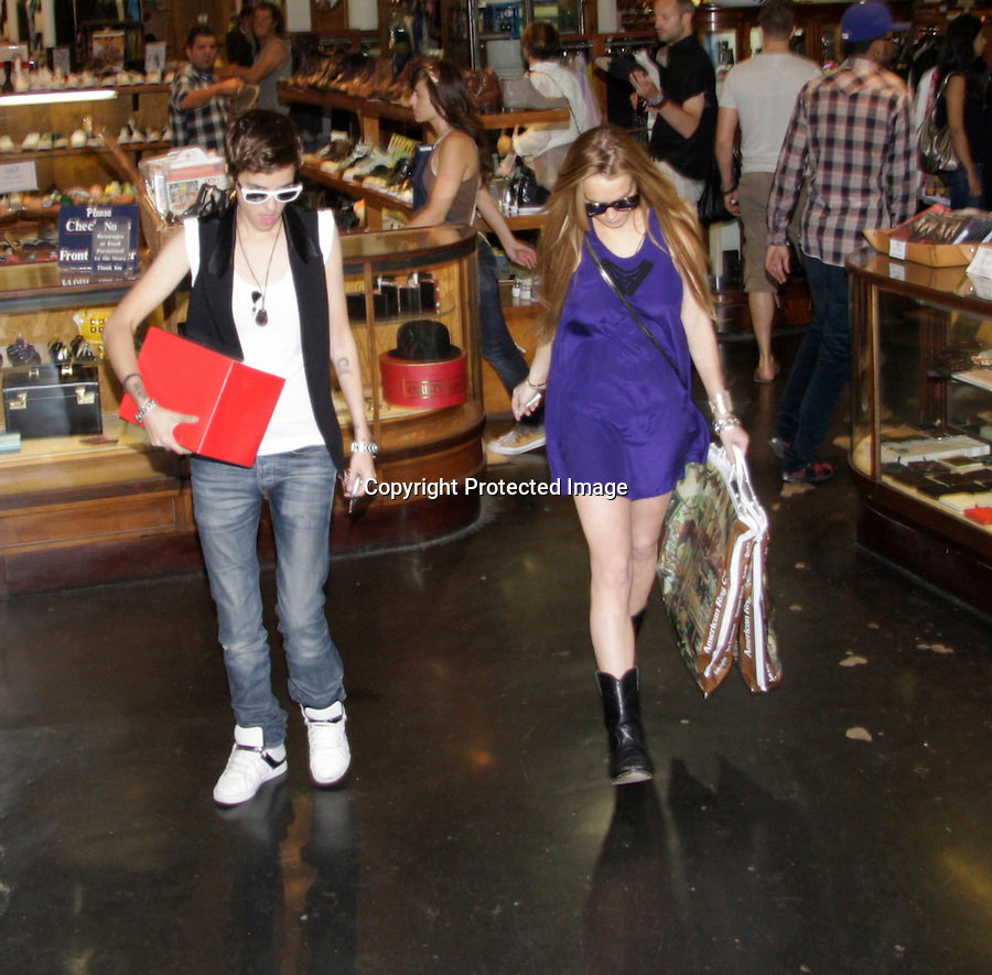 """9-25-08..Lindsay Lohan shopping at a store called """"American Rag"""" with Samantha Ronson in Los Angeles ca. Samantha picked up a pink skull & was joking with Lindsay about it.  When leaving Lindsay and Samantha both got into her Porsche then Lindsay kissed  Samantha goodbye real quick & got out of the Porsche. Nobody got a picture. Then Lindsay jumped in another friends car and gave her a ride back to her hotel.  ..AbilityFilms@yahoo.com.805-427-3519.www.AbilityFilms.com"""