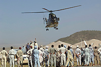 The helicopter of President Asif Ali Zardari lifts off after he paid a short surprise visit to the Swabi Refugee camp. The camp is run by Red Cross/Red Crescent (ICRC), and currently houses around 18,000 refugees. The Pakistani government began an offensive against the Taliban in the Swat Valley in April 2009, which led to a major humanitarian crisis. Up to two million civilians were estimated to have been displaced by the fighting.