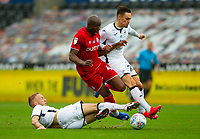 18th July 2020; Liberty Stadium, Swansea, Glamorgan, Wales; English Football League Championship, Swansea City versus Bristol City; Benik Afobe of Bristol City is tackled by Mike van der Hoorn of Swansea City