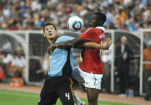 28 July 2010: Omar Gonzalez of the MLS All-Stars gets tangled up with Danny Welbeck of Manchester United during the MLS All-Star Game. Manchester United defeated the MLS All-Stars 5-2 at Reliant Stadium in Houston, TX