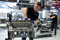 Mercedes-AMG engine production factory in Affalterbach, Germany - engineer checking 6.3 litre V8 engine block to clear swarf