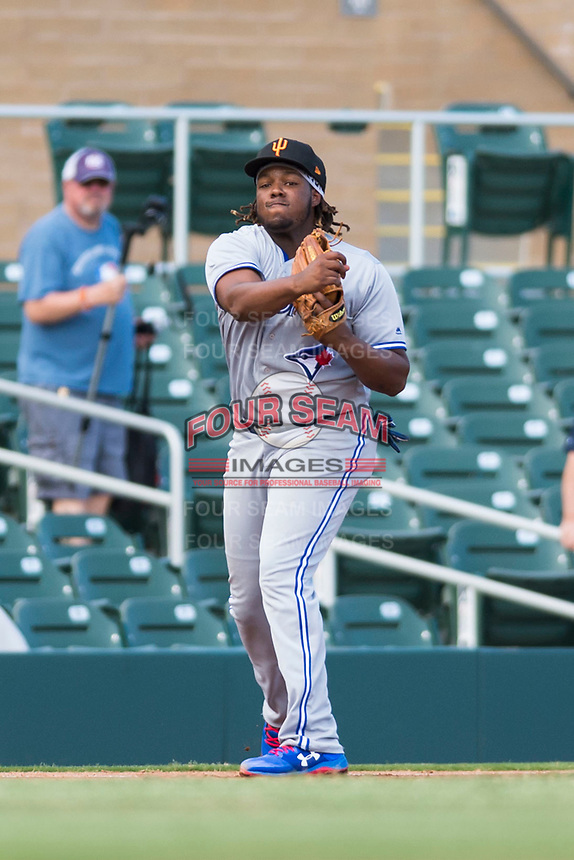 Surprise Saguaros third baseman Vladimir Guerrero Jr. (27), of the Toronto Blue Jays organization, throws to first base during an Arizona Fall League game against the Salt River Rafters at Salt River Fields at Talking Stick on October 23, 2018 in Scottsdale, Arizona. Salt River defeated Surprise 7-5 . (Zachary Lucy/Four Seam Images)