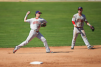 Auburn Doubledays shortstop Clayton Brandt (3) throws to first base as second baseman Dalton Dulin (1) looks on during the first game of a doubleheader against the Batavia Muckdogs on September 4, 2016 at Dwyer Stadium in Batavia, New York.  Batavia defeated Auburn 1-0 in a continuation of a game started on August 13. (Mike Janes/Four Seam Images)