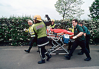 Firefighters and Paramedics rushing a casualty on a stretcher from a RTA to the awaiting HEMS helicopter based at the Royal London Hospital. This image may only be used to portray the subject in a positive manner..©shoutpictures.com..john@shoutpictures.com