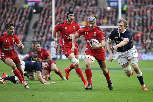 15.02.2015.  Edinburgh, Scotland. 6 Nations Championship. Scotland versus Wales. Scotland's Jonny Gray cannot stop the try charge by Wales's Jonathan Davies.