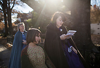 NWA Democrat-Gazette/CHARLIE KAIJO Julia Stilwell, 10 and JoAnna Saunders, 13, (from left) sing as they go caroling during the Washco Historical Society annual Holiday Open House, Sunday, December 2, 2018 at the Headquarters House in Fayetteville.<br />