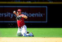 Apr. 27, 2011; Phoenix, AZ, USA; Arizona Diamondbacks shortstop Stephen Drew makes a throw from his knees in the third inning against the Philadelphia Phillies at Chase Field. Mandatory Credit: Mark J. Rebilas-