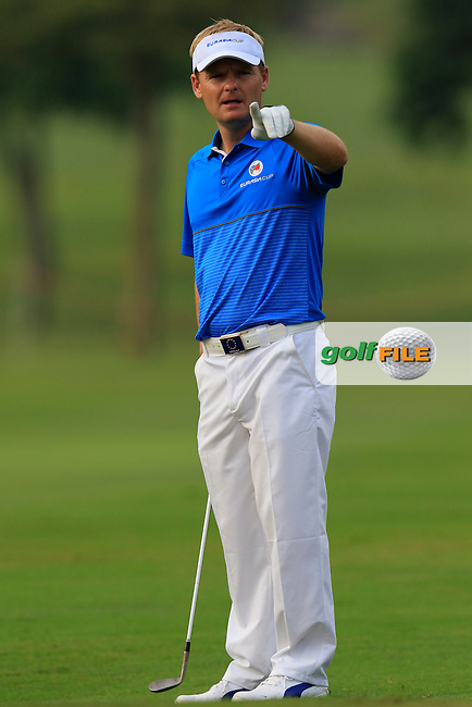 Soren Kjeldsen (DEN) Team Europe prepares to chip onto the 1st green during Match 1 of Friday's Fourball Matches of the 2016 Eurasia Cup presented by DRB-HICOM, held at the Glenmarie Golf &amp; Country Club, Kuala Lumpur, Malaysia. 15th January 2016.<br /> Picture: Eoin Clarke | Golffile<br /> <br /> <br /> <br /> All photos usage must carry mandatory copyright credit (&copy; Golffile | Eoin Clarke)