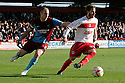 Robin Shroot of Stevenage escapes from David Mirfin of Scunthorpe. Stevenage v Scunthorpe United - npower League 1 -  Lamex Stadium, Stevenage - 6th October, 2012. © Kevin Coleman 2012