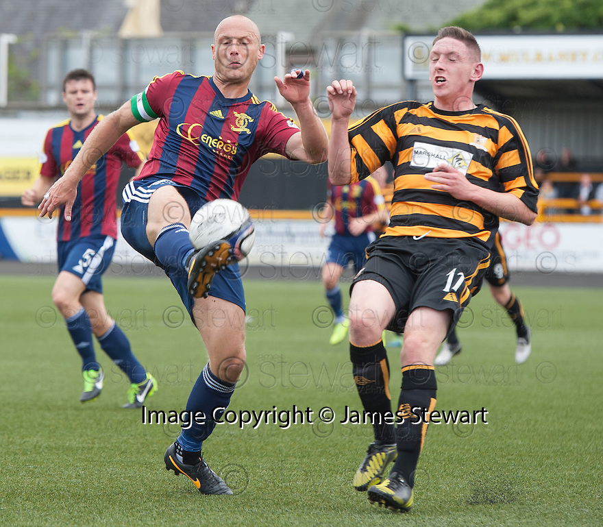 Livy's Simon Mensing clears from Alloa's Declan McManus.