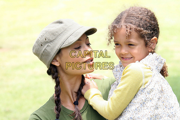 "THANDIE NEWTON & RIPLEY.""A Time For Heroes"" Celebrity Carnival To Benefit the Elizabeth Glaser Pediatric Aids Foundation - Arrivals held at the Wadsworth Theater on the Veterans Administration Lawn, Los Angeles, California, USA.June 11th, 2006.Photo: Zach Lipp/AdMedia/Capital Pictures.Ref: ZL/ADM.headshot portrait daughter mother family carrying braids plaits  baseball cap hat .www.capitalpictures.com.sales@capitalpictures.com.© Capital Pictures."