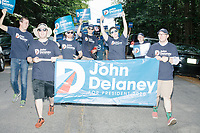 Supporters of Democratic presidential candidate and former Maryland representative John Delaney march in the 4th of July parade in Amherst, New Hampshire, on Thu., July 4, 2019.