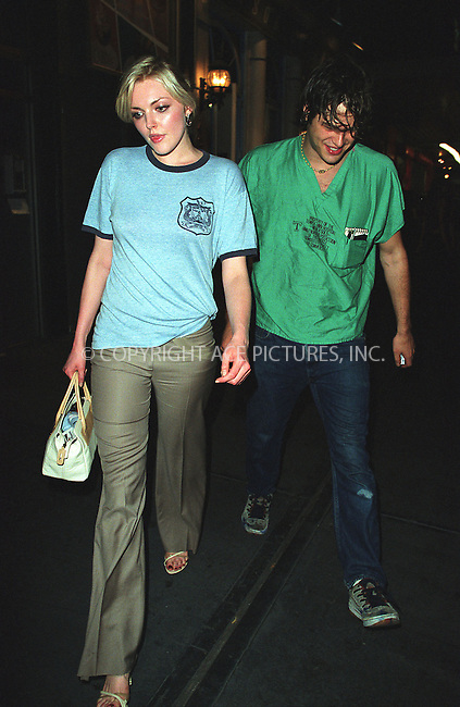 "Britain's top model Sophie Dahl and unidentified friend arrive at New York's trendy Lotus club to attend a Wednesday night party. Sophie's companion perhaps is the medical doctor because he is wearing a shirt labeled, ""Property of the Temple University Hospital..."" New York, June 26, 2002. Please byline: Alecsey Boldeskul/NY Photo Press.   ..*PAY-PER-USE*      ....NY Photo Press:  ..phone (646) 267-6913;   ..e-mail: info@nyphotopress.com"