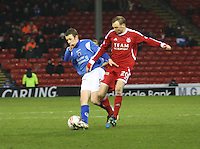 Scott McLaughlin being tackled by Stephen Hughes in the Aberdeen v Queen of the South William Hill Scottish Cup 5th Round match played at Pittodrie Stadium, Aberdeen on 4.2.12...