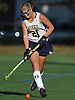 Shannon Bernhardt #21 of Massapequa moves the ball downfield during a Nassau County Conference I varsity field hockey match against Baldwin at Field of Dreams Park in Massapequa on Monday, Sept. 26, 2016. She tallied three assists in Massapequa's 5-0 win.
