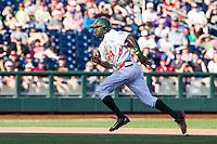 Miami Hurricanes outfielder Jacob Heyward (24) runs towards third base during the NCAA College baseball World Series against the Arkansas Razorbacks  on June 15, 2015 at TD Ameritrade Park in Omaha, Nebraska. Miami beat Arkansas 4-3. (Andrew Woolley/Four Seam Images)