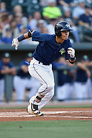 Shortstop Andres Gimenez (13) of the Columbia Fireflies runs toward first in a game against  the West Virginia Power on Thursday, May 18, 2017, at Spirit Communications Park in Columbia, South Carolina. Columbia won in 10 innings, 3-2. (Tom Priddy/Four Seam Images)