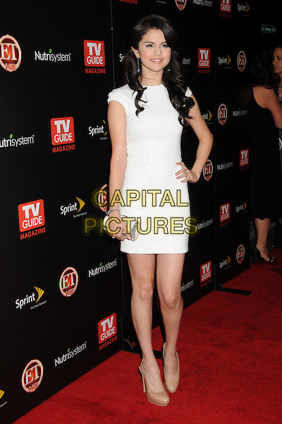 SELENA GOMEZ.TV Guide Magazine's Hot List Party 2009 held at the SLS Hotel, Los Angeles, California, USA..November 10th, 2009.full length white silver clutch bag beige shoes dress hand on hip.CAP/ADM/BP.©Byron Purvis/AdMedia/Capital Pictures.
