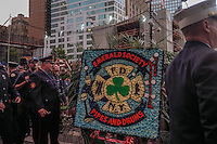 NEW YORK, NY - SEPTEMBER 11, 2016: The FDNY Emerald Society Pipes and Drums band plays at Ground Zero at sunset, honoring the 343 firefighters that were killed during the 15th anniversary of the 9/11 attacks on September 11, 2016 in New York. Photo by (VIEWpress/Maite H. Mateo)
