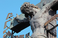 Detail of the Crucifix and Calvary sculpture, installed 1657, on the Charles Bridge or Karluv most over the Vltava river, Prague, Czech Republic. Bought in Dresden, this crucifix was originally made in 1629 by H Hillger after a design by W E Brohn. The golden Hebrew text was added in 1696, when the Prague authorities accused a local Jewish leader, Elias Backoffen, of blasphemy. His punishment was to raise funds for gold-plated Hebrew letters, spelling out the Kedusha from a Hebrew prayer. The inscription was a symbolic humiliation of Prague Jews. The historic centre of Prague was declared a UNESCO World Heritage Site in 1992. Picture by Manuel Cohen