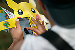 A man plays ''Pokemon Go'' on his smartphone on one of the hottest days of the summer at Pokemon GO PARK in Yokohama Minatomirai on August 9, 2017, Yokohama, Japan. Hundreds of Pokemon GO app fans gathered at the special Pokemon GO PARK, a 2km area including special PokeStops and PokemonGyms, to collect characters. Minatomirai holds an annual Pokemon event including a parade of 1500 Pikachu through the area and this year has added Pokemon GO attractions. Pokemon GO PARK is open from August 9 to 15. (Photo by Rodrigo Reyes Marin/AFLO)