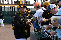 Pittsburgh Pirates manager Clint Hurdle (13) signs autographs before the Black & Gold intrasquad game on March 2, 2015 at McKechnie Field in Bradenton, Florida.  (Mike Janes/Four Seam Images)