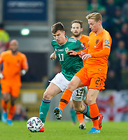 16th November 2019; Windsor Park, Belfast, Antrim County, Northern Ireland; European Championships 2020 Qualifier, Northern Ireland versus Netherlands; Paddy McNair of Northern Ireland and Frenkie de Jong of Netherlands challenge for the ball - Editorial Use