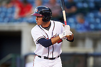 Mississippi Braves shortstop Eric Garcia (4) at bat during a game against the Pensacola Blue Wahoos on May 27, 2015 at Trustmark Park in Pearl, Mississippi.  Pensacola defeated Mississippi 7-5 in fourteen innings.  (Mike Janes/Four Seam Images)