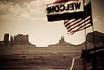 Welcome flags fly in the wind along Highway 163 in Monument Valley, Arizona.